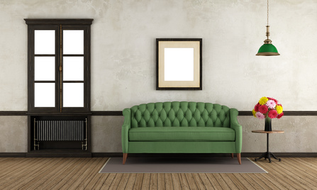 coaching dargestellt durch grüne couch im raum